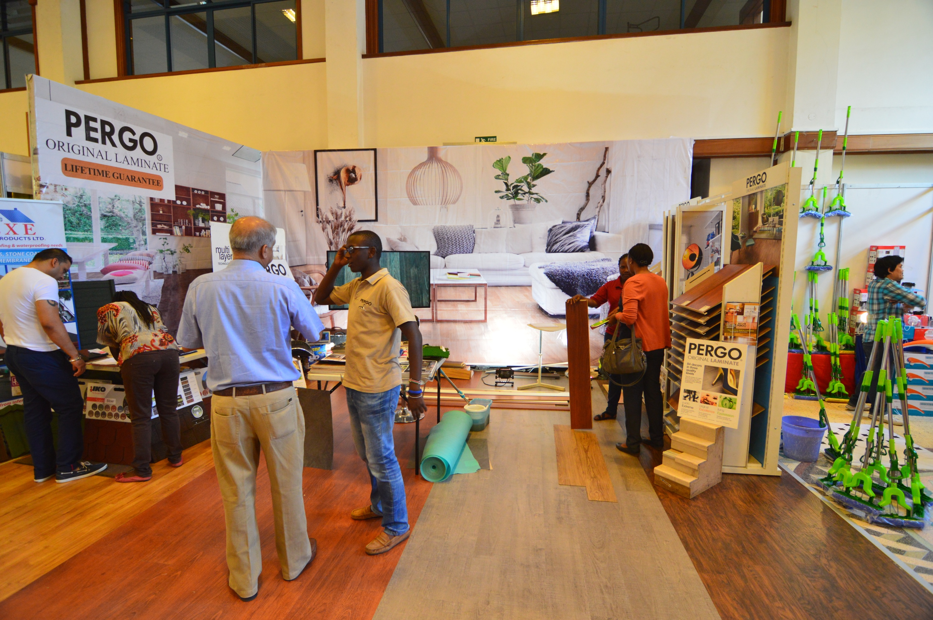 Antony and Teresa taking clients through the PERGO® Floor designs at the Ideal Interiors Expo ,Nairobi