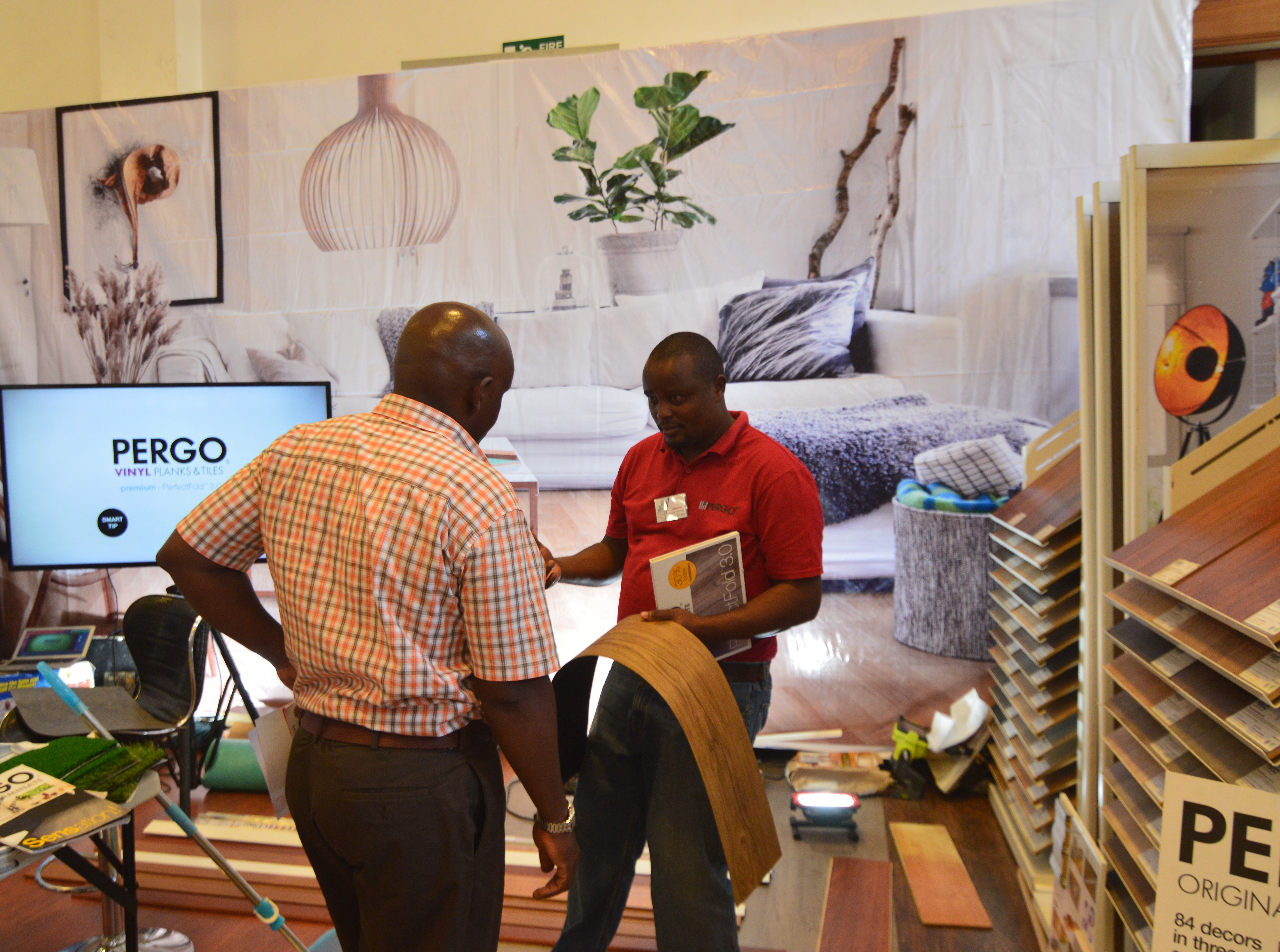 Amos taking a potential client through the PERGO® LVT Floor .